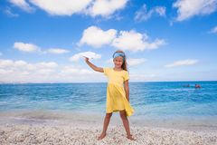 Happy little girl with paper airplane during beach Royalty Free Stock Images