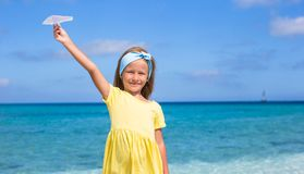 Happy little girl with paper airplane in hands on Royalty Free Stock Image