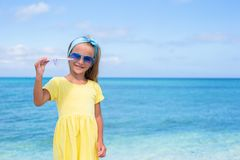 Happy little girl with paper airplane in hands on Royalty Free Stock Photos
