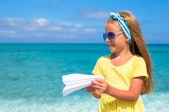 Happy little girl with paper airplane in hands on Royalty Free Stock Images