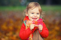 Happy little girl in the park Royalty Free Stock Images