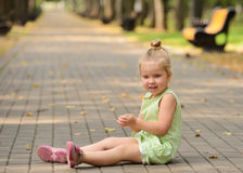 Happy little girl in the park Stock Photos