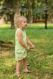 Happy little girl in the park Stock Image