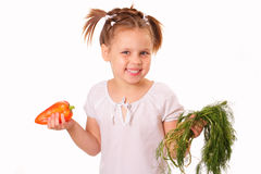 Happy little girl with pepper and dill Stock Images