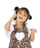 Happy little girl on the phone Royalty Free Stock Image