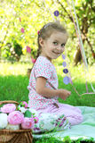 Happy little girl on picnic with flowers Royalty Free Stock Photos