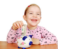 Happy little girl with piggy bank Royalty Free Stock Image