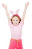 Happy little girl with pink ears bunny Stock Image