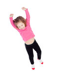 Happy little girl in pink jumping Stock Image