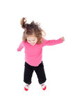 Happy little girl in pink jumping Royalty Free Stock Photos