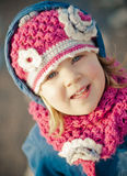Happy little girl. A happy little girl in a pink woolly hat and scarf Royalty Free Stock Photography