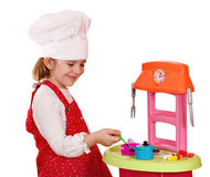 Little girl play cooking Stock Image