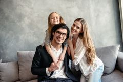 Happy little girl play with her mother and father. On the sofa royalty free stock photos