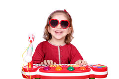 Happy little girl with play music Stock Photo