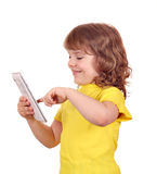 Happy little girl play with tablet pc Royalty Free Stock Photography