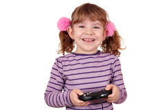 Little girl play video game on white. Happy little girl play video game on white Stock Photos