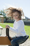 Happy little girl on a playground Stock Images