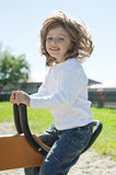Happy little girl on a playground Royalty Free Stock Image