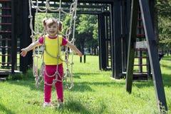 Happy little girl playground Stock Image