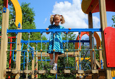 Happy little girl on playground Royalty Free Stock Photo