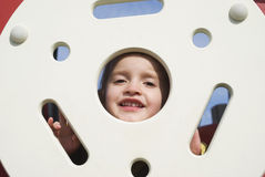 Happy little girl on the playground Stock Photo