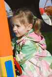 Happy little girl on the playground Stock Photography