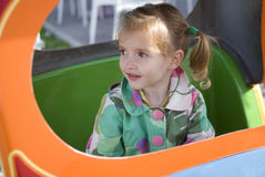 Happy little girl on the playground Stock Photos
