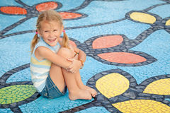 Happy little girl on the playground. At the day time Royalty Free Stock Photo