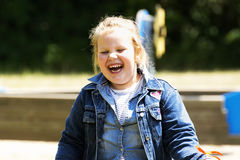 Happy little girl at playground royalty free stock photos