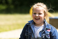 Happy little girl at playground stock photography