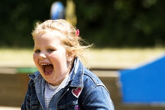 Happy little girl at playground royalty free stock photography