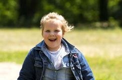 Happy little girl at playground stock image
