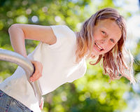 Happy Little Girl on Playground. With Trees in Background Royalty Free Stock Image