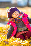 Happy little girl playing in the autumn park Stock Image