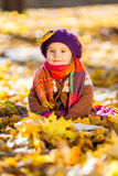 Happy little girl playing in the autumn park Royalty Free Stock Image