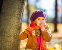Happy little girl playing in the autumn park Royalty Free Stock Images