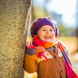 Happy little girl playing in the autumn park Stock Photography