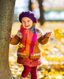 Happy little girl playing in the autumn park Stock Photo