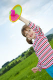 Happy little girl playing with a ball outdoor Stock Image