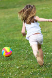 Happy little girl playing ball in the park. Stock Photography