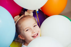 Happy little girl playing with balloons Royalty Free Stock Image