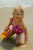 Happy Little Girl Playing at the Beach Royalty Free Stock Images