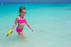 Happy little girl playing at beach during caribbean vacation Royalty Free Stock Photos