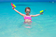 Happy little girl playing at beach during Royalty Free Stock Image