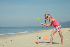 Happy Little girl  playing on the beach. At the day time Royalty Free Stock Photo