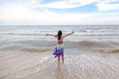 Happy little girl playing on the beach royalty free stock photos