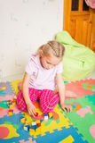 Happy little girl playing with blocks Stock Photo