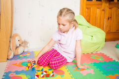 Happy little girl playing with blocks Stock Image
