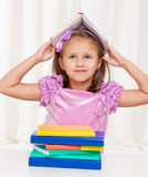 Happy little girl playing with books Royalty Free Stock Photo