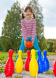 Happy Little Girl Playing Bowling Royalty Free Stock Photos